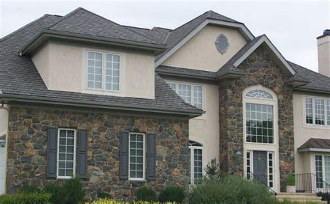 model rumah minimalis tampak depan elemen batu alam